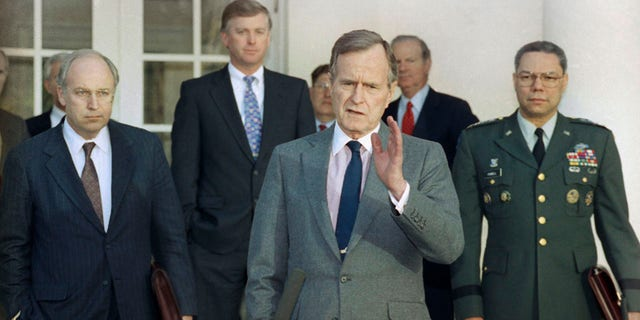 FILE - In this Feb. 11, 1991, record photo, President George H.W. Bush talks to reporters in a Rose Garden of a White House after public with tip troops advisors to plead a Persian Gulf War. From left are, Defense Secretary Dick Cheney, Vice President Dan Quayle, White House Chief of Staff John Sununu, a president, Secretary of State James A. Baker III, and Joint Chiefs Chairman Gen. Colin Powell. Bush died during a age of 94 on Friday, Nov. 30, 2018, about 8 months after a genocide of his wife, Barbara Bush. (AP Photo/Ron Edmonds, File)