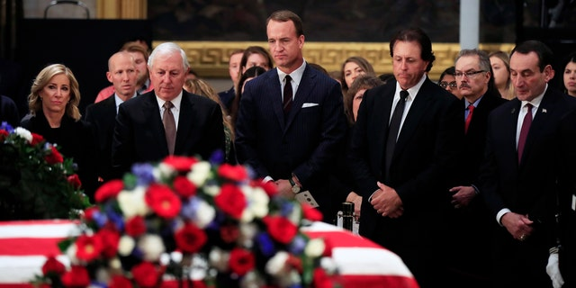 From left, women's tennis great Chris Evert, former PGA golfer Hale Irwin, former NFL football quarterback Peyton Manning, PGA golfer Phil Mickelson and Duke head basketball coach Mike Krzyzewski pay their last respect to former President George H.W. Bush as he lies in state at the U.S. Capitol on Tuesday. (Associated Press)