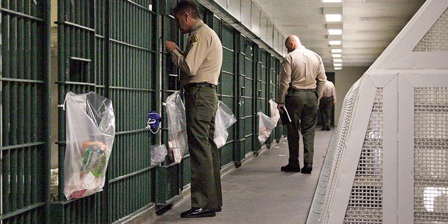 Los Angeles County deputies inspecting a cell block at the Men's Central Jail in downtown Los Angeles in 2012.