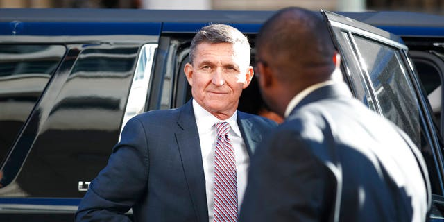 President Donald Trump's former National Security Advisor Michael Flynn arrives at federal court in Washington, Tuesday, Dec. 18, 2018. (AP Photo/Carolyn Kaster)