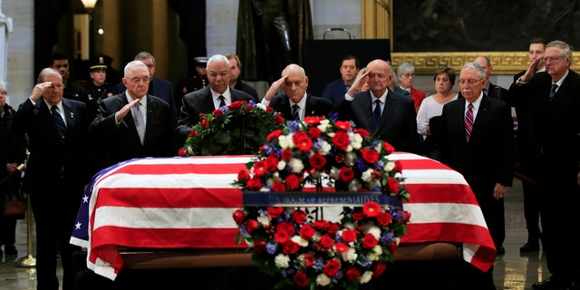 Former Secretary of State Colin Powell, third from left, leads former Operation Desert Storm commanders as they pay their last respects to former President George H.W. Bush as he lies in state at the U.S. Capitol in Washington, Tuesday. (Associated Press)