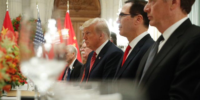 President Trump and Treasury Secretary Steve Mnuchin, second from right, listening to remarks by Chinese President Xi Jinping during a bilateral meeting at the G20 Summit in December 2018. Trump threatened to raise tariffs on $200 billion worth of Chinese goods on Sunday.