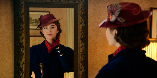 This image released by Disney shows Emily Blunt as Mary Poppins in 'Mary Poppins Returns.'