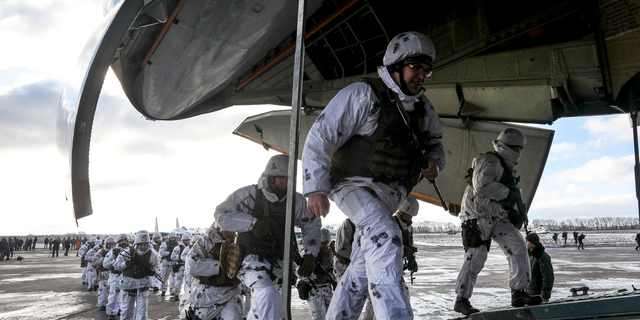 Soldiers of the Ukrainian air assault units board a military cargo aircraft at a military base in the Zhytomyr region, Ukraine, Thursday, Dec. 6, 2018. The long-simmering conflict between Russia and Ukraine that started with Russia's annexation of Crimea spilled into the open on Nov. 25 when the Russian coast guard fired upon and seized three Ukrainian naval vessels and their crews, to which Ukrainian President Petro Poroshenko responded by introducing a martial law for 30 days and Ukraine has beefed up its forces on the border with Russia. (Mikhail Palinchak, Presidential Press Service via AP)