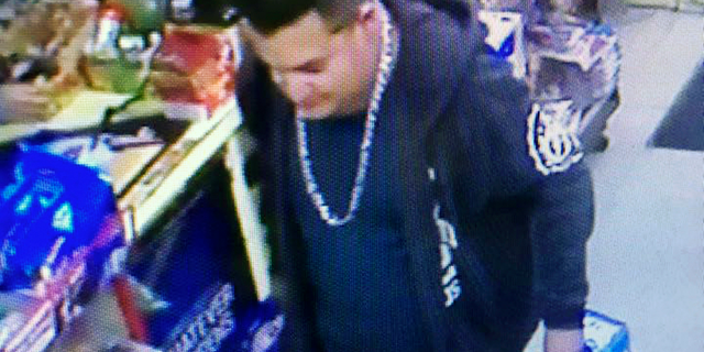 This Wednesday, Dec. 26 image from a surveillance camera video and provided by the Stanislaus County Sheriff's Department shows a suspect police are searching for in connection to the fatal shooting of an officer during a traffic stop in Northern California. (Stanislaus County Sheriff's Department via AP)