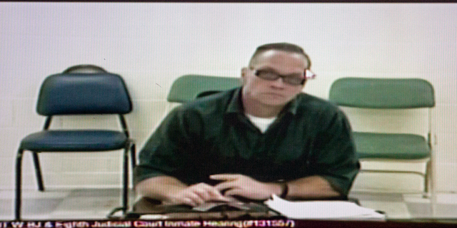 In this Dec. 5, 2017, file photo, Nevada death row inmate Scott Dozier appears for his court hearing via video at the Regional Justice Center in Las Vegas. (Erik Verduzco/Las Vegas Review-Journal via AP)