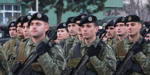 Members of Kosovo Security Force line up for inspection by Kosovo president Hashim Thaci in capital Pristina, Kosovo, on Thursday, Dec. 13, 2018. Kosovo lawmakers are set to transform the Kosovo Security Force into a regular army. (AP Photo/Visar Kryeziu)