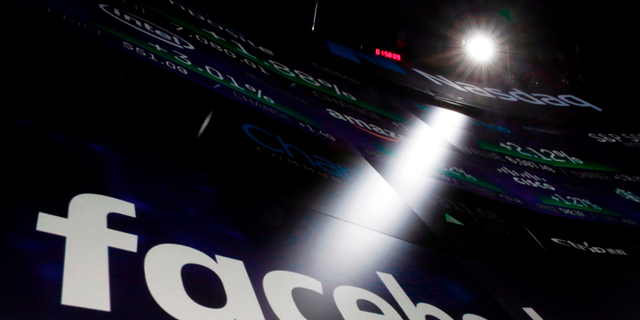 FILE- In this March 29, 2018, file photo, the logo for Facebook appears on screens at the Nasdaq MarketSite in New York's Times Square.