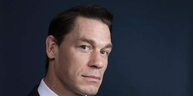 """This Dec. 9, 2018 photo shows WWE star-turned-actor John Cena posing for a portrait at the Four Seasons Hotel to promote his film """"Bumblebee"""" in Los Angeles."""