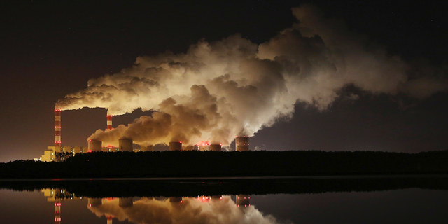 FILE -- Plumes of smoke rise from Europe's largest lignite power plant in Belchatow, central Poland. (AP Photo/Czarek Sokolowski)