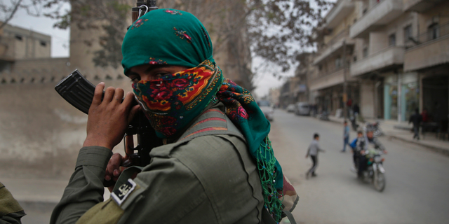 A member of the Kurdish internal security forces on a patrol in Manbij, north Syria, in March 2018. (AP Photo/Hussein Malla, File)