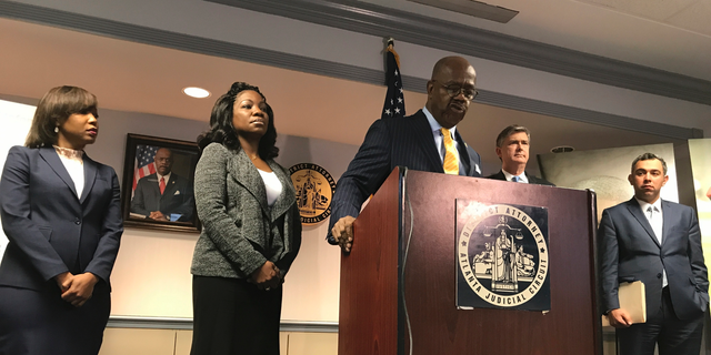 Fulton County District Attorney Paul Howard discusses his attempts to obtain information about the killing of Jamarion Robinson, who was shot 59 times by law enforcement officers, on Friday, Dec. 28, 2018. (AP Photo/Jeff Martin)