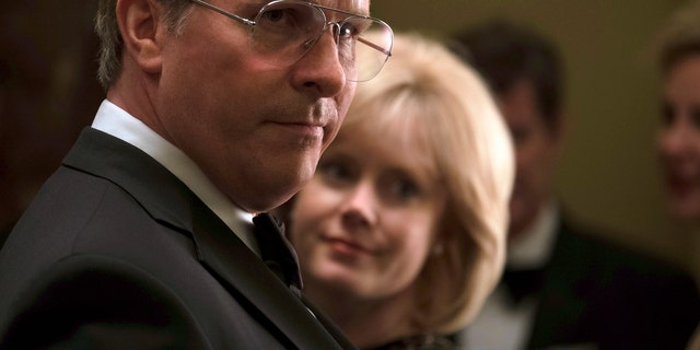"This image released by Annapurna Pictures shows Christian Bale as Dick Cheney, left, and Amy Adams as Lynne Cheney in a scene from ""Vice."""