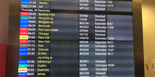 The arrivals board at Gatwick Airport showing cancelled, diverted and delayed flights as the airport remains closed with incoming flights delayed or diverted to other airports, after drones were spotted over the airfield last night and this morning Thursday Dec. 20, 2018. London's Gatwick Airport remained shut during the busy holiday period Thursday while police and airport officials investigate reports that drones were flying in the area of the airfield. (Thomas Hornall/PA via AP)