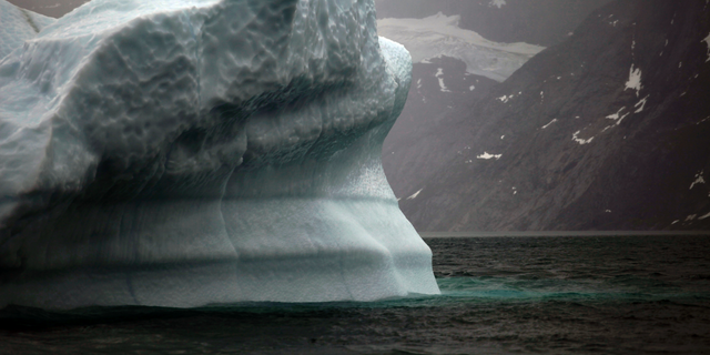 FILE- In this July 26, 2011 photo, a melting iceberg floats along a fjord leading away from the edge of the Greenland ice sheet near Nuuk, Greenland. Massive ice sheets in western Antarctica and Greenland are melting much faster than scientists figured a quarter century ago. Greenland has lost more than 5 trillion tons since 1992. International talks to fight global warming are set to start in Poland next week. (AP Photo/Brennan Linsley, File)