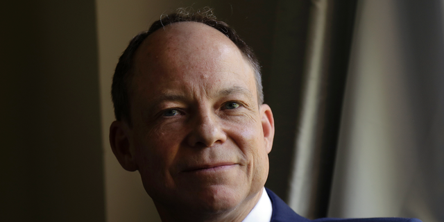FILE - In this May 15, 2018 file photo, Judge Aaron Persky poses for photos in Los Altos Hills, Calif. Persky, the first California judge to be recalled in nearly a century is asking people to donate money so he can pay $135,000 in court-ordered attorney's fees to his victors' lawyer. (AP Photo/Jeff Chiu, File)