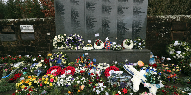 A general view of floral tributes which have been laid by the main memorial stone in memory of the victims of Pan Am flight 103 bombing, in the garden of remembrance at Dryfesdale Cemetery, near Lockerbie, Scotland. Friday Dec. 21, 2018. Memorial services are being held in Scotland and the United States to remember the 270 people killed when a Pan Am passenger plane exploded over the town of Lockerbie 30 years ago.