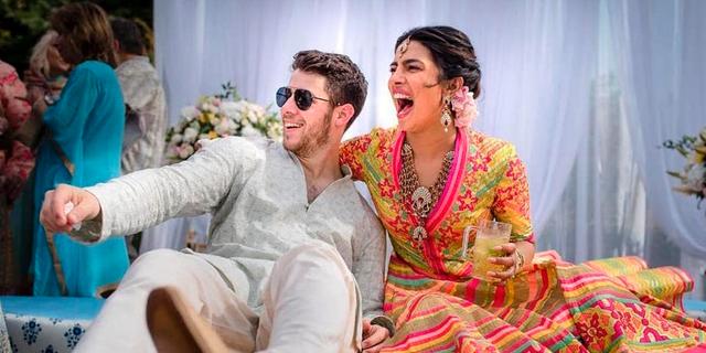 Priyanka Chopra and Nick Jonas celebrate during a mehendi ceremony, a day before their wedding, at Umaid Bhawan in Jodhpur, India.