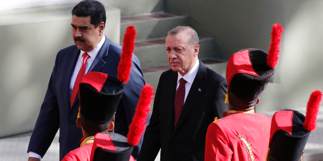 Venezuela's President Nicolas Maduro receives Turkey's President Recep Tayyip Erdogan at the Miraflores Presidential Palace in Caracas, Venezuela, Monday, Dec. 3, 2018. Erdogan is on a one-day official visit to the country. (AP Photo/Ariana Cubillos)