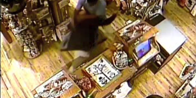 The suspect lunged at the employee, knocking him into the store's merchandise.