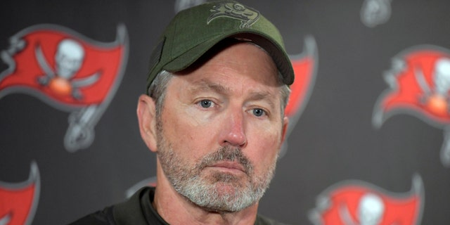 FILE - In this Sunday, Nov. 18, 2018 file photo, Tampa Bay Buccaneers head coach Dirk Koetter talks to reporters after an NFL football game against the New York Giants in East Rutherford, N.J.