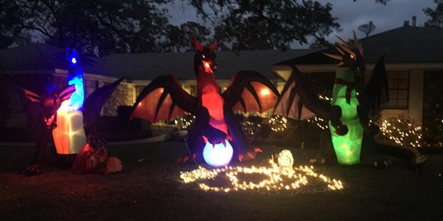 Rowland had initially put up three dragons but, not one to back down, added two more after her neighbor's letter.