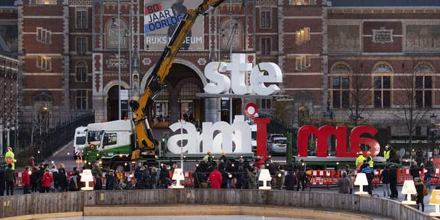 """The red and white letters """"I Amsterdam"""" are removed from the Museumplein (Museum Square) in Amsterdam, on December 3, 2018."""