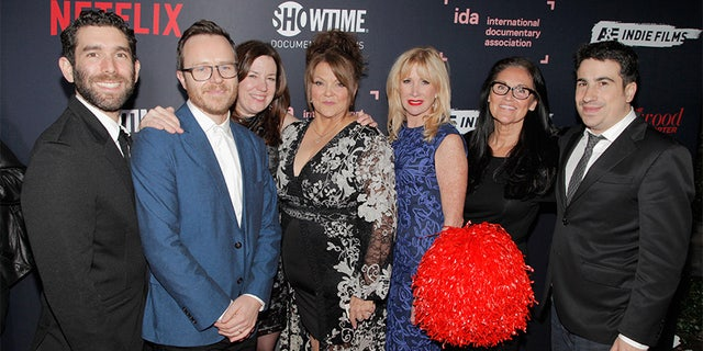 "Jason Goldman, Galen Summer, Molly Thompson, Jackie Rohrs, Rhonda Crossland, Lynita Stuart, Van Beneden and Jeremy Yaches of ""Sidelined'"" attend the 2018 IDA Documentary Awards on December 8, 2018 in Los Angeles, California. — Getty"