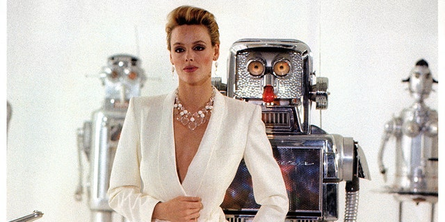 "Brigitte Nielsen standing in front of robots in a scene from the film ""Cobra,"" 1986. — Getty"