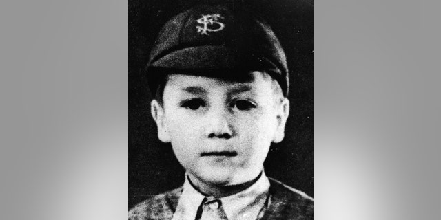 Headshot portrait of British musician and songwriter John Lennon (1940 -1980), of the pop group The Beatles, as a young boy in a school uniform and cap, c. 1948.