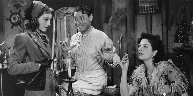 """Elisabeth Bergner (1898 - 1986) with Eduardo Ciannelli (1887 - 1969) and Gale Sondergaard (1899 - 1985) in a scene from the film """"Paris Calling."""" — Getty"""