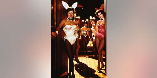 Bunny Bonnie (light outfit) and Bunny Kelly (in red) pose at the Chicago Playboy Club.