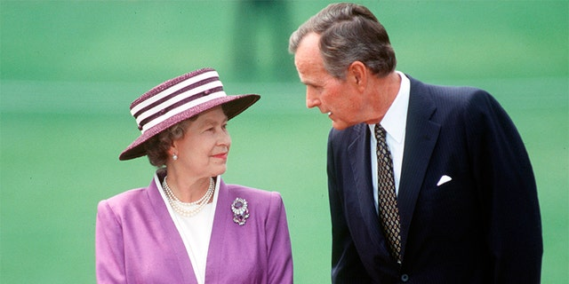 George H.W. Bush and Queen Elizabeth II. — Getty