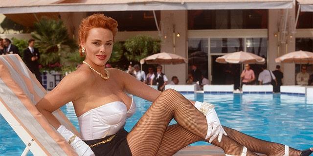 Brigitte Nielsen seen poolside at the Cannes Film Festival in 1992.