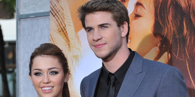 "MIley Cyrus and Liam Hemsworth at the premiere of ""The Last Song."""