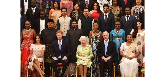 A family affair! Meghan and Harry sit next to Queen Elizabeth II and John Major at the Queen's Young Leaders Awards Ceremony at Buckingham Palace on June 26, 2018 in London, England.