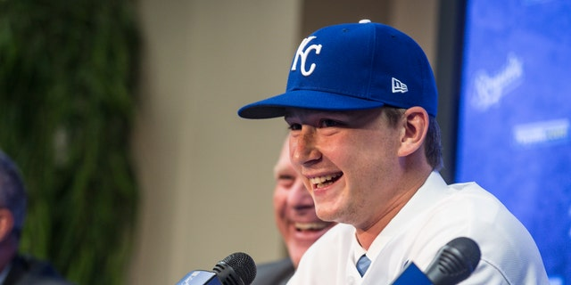The 2018 Kansas City Royals first-round pick pitcher Brady Singer smiles during a press conference before the game between the Cleveland Indians and the Kansas City Royals at Kauffman Stadium on July 3, 2018 in Kansas City, Missouri. (Photo by Brian Davidson/Getty Images)