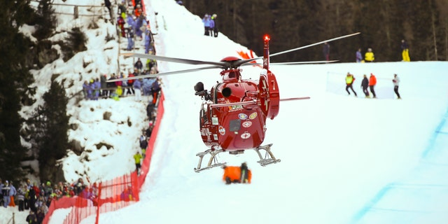 A rescue helicopter leaves with on board Switzerland's Marc Gisin after he crashed on the course during a men's World Cup downhill, in Val Gardena, Italy, Saturday, Dec. 15, 2018.