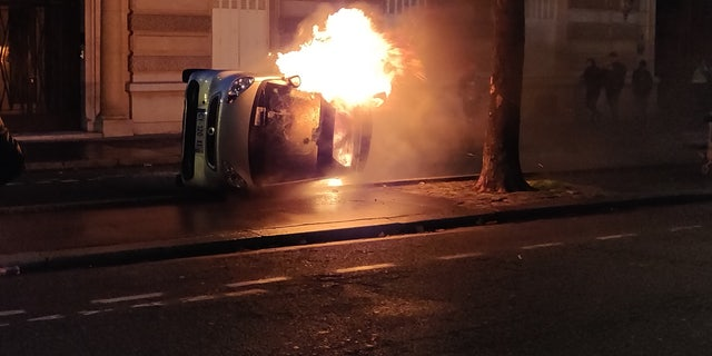 Protesters set a car on fire Saturday evening after a day of clashes with police.