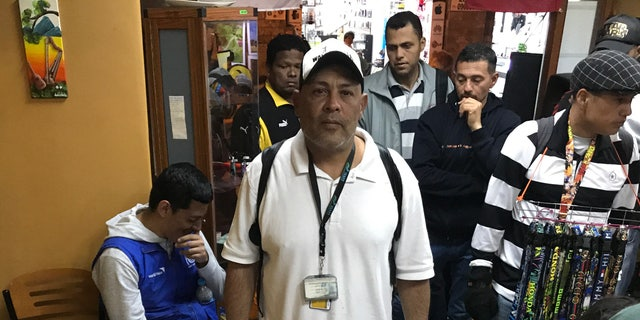 Alexander Lopez, now working on the streets in Cuenca, Ecuador struggled to send money back to his native Venezuela to retrieve his son's body.