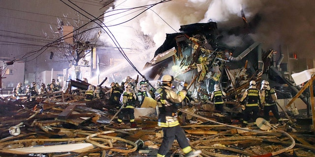 Firefighters operate at the site where a large explosion occurred at a restaurant in Sapporo, Hokkaido, northern Japan, in this photo taken by Kyodo December 16, 2018.