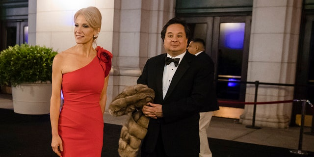 President-elect Donald Trump adviser Kellyanne Conway center accompanied by her husband George speaks with members of the media as they arrive for a dinner at Union Station in Washington the day before Trump's