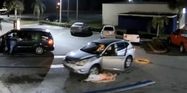 The woman was nearly run over during the altercation.