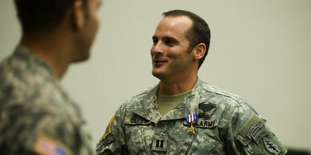 U.S Army Capt. Mathew Golsteyn is congratulated in 2011 by fellow soldiers following the Valor Awards ceremony for 3rd Special Forces Group at Fort Bragg, N.C.