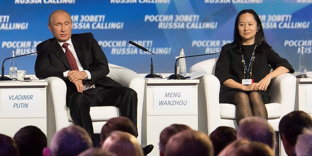 "Wanzhou with Russian President Vladimir Putin at a session of the VTB Capital Investment Forum ""Russia Calling!"" in Moscow, in 2014."