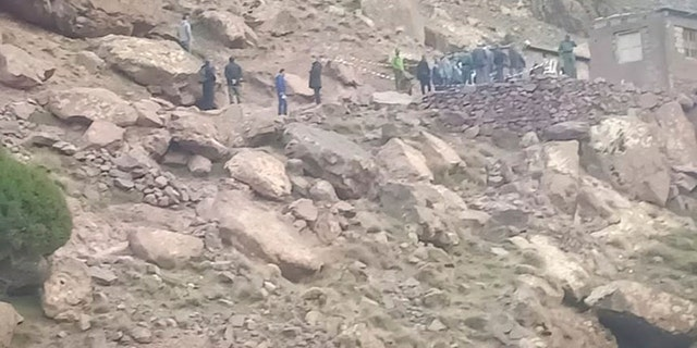 This photo provided by Moroccan News website, Marrakechalaan.com, and dated Monday, Dec. 18, 2018, shows security personnel at the scene where the bodies of two Scandinavian women tourists were found dead, near Imlil in the High Atlas mountains, Morocco.