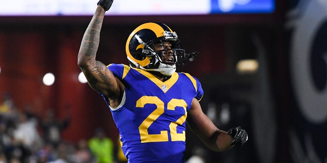 Cornerback Marcus Peters #22 of the Los Angeles Rams urges on the crowd during the fourth quarter against the Philadelphia Eagles at Los Angeles Memorial Coliseum on December 16, 2018 in Los Angeles, California.
