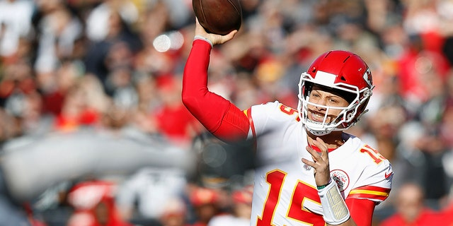 Kansas City Chiefs quarterback Patrick Mahomes (15) passes against the Oakland Raiders during the first half of an NFL football game in Oakland, Calif., Sunday, Dec. 2, 2018.