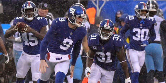 New York Giants punter Riley Dixon (9) reacts after running a fake punt for a first down against the Tennessee Titans during the first half of an NFL football game, Sunday, Dec. 16, 2018, in East Rutherford, N.J.(Associated Press)