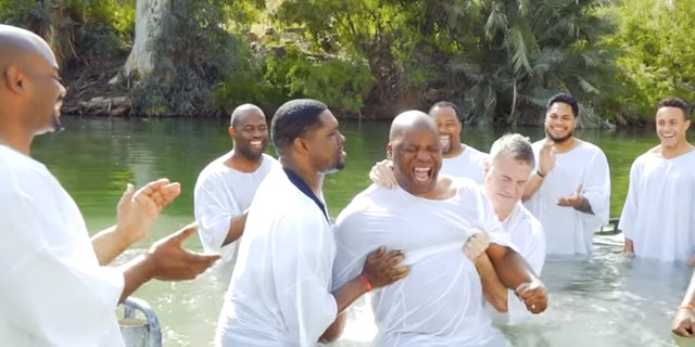 A group from the NFL was baptized in the Jordan River on a trip with Israel Collective in March.